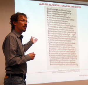 Sándor Chardonnens exhibits the list of 'Cats in Alphabetical Dream Books' in his paper for the session on 'Predicting the Past' at the 2015 International Congress on Medieval Studies. Photography © Mildred Budny