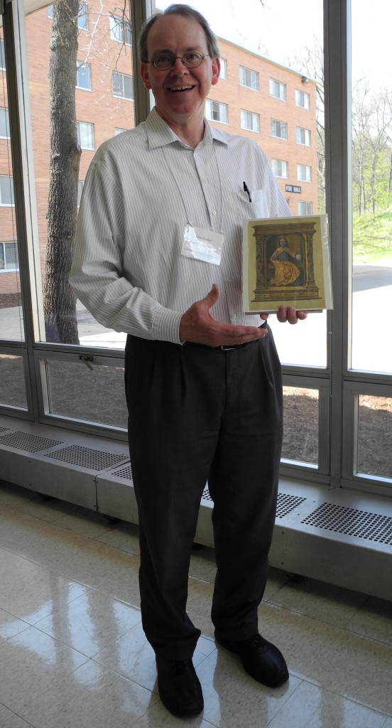 Jesse Hurlbut holds his newly won manuscript leaf at the Kalamazoo Congress on 10 May 2014. (Photography by Mildred Budny)