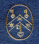 Gold stamp on blue cloth of the logo of the Research Group on Manuscript Evidence. Detail from the front cover of Volume II of 'The Illustrated Catalogue'