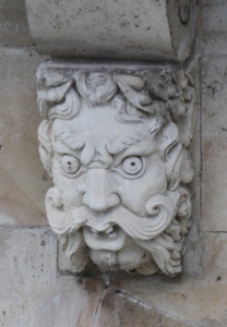 Corbel head with handlebar moustache on Le Pont Neuf, Paris, with photography by Ilya V. Sverdlov