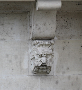 Frowning Corbel Head on Le Pont Neuf, Paris. Photograpny by Ilya V. Sverdlov