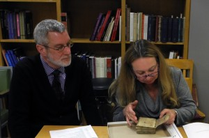 Inspecting the despoiled Book of Hours at our 'Show & Tell' Seminar on Manuscripts & Their Photographs on 9 December 2014