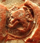 The red wax seal seen upright, with the male human head facing left. Document on paper issued at Grenoble and dated 13 February 1345 (Old Style). Image reproduced by permission