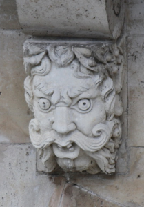 Corbel Head with handlebar moustache on Le Pont Neuf, Paris. Photograph by Ilya V. Sverdlov, reproduced by permission