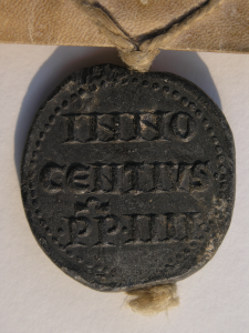 Reverse of Bulla of Pope Innocent IV with the inscription of his name in three lines. Photography © Mildred Budny