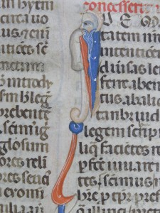 Initial I of Idem for Justinian's Novel Number 134, with bearded human facing left at the top of the stem of the letter. Photography © Mildred Budny