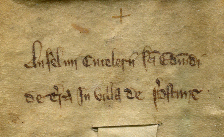 Docketing inscription on the dorse of a deed of sale of of land at Preston, near Ipswich, circa 1200, cropped to the left-hand half of the column of its text. Reproduced by permission.