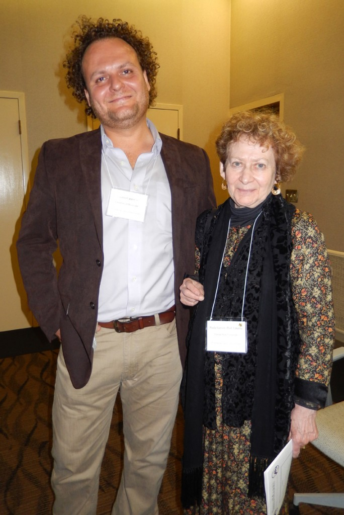 Two Attendees at the 2015 Reception at the 50th International Congress on Medieval Studies. They stand facing the photographer and smile. Photography © Mildred Budny