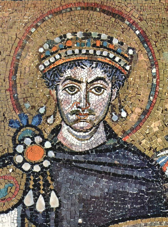 The frontal image of the crowned and bejeweled emperor Justinian I stares toward the future. Image in the public domain via Wikipedia Commons.