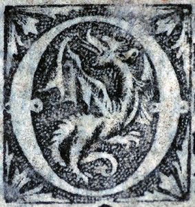 Printed Initial O with winged dragon. Photograph © Mildred Budny