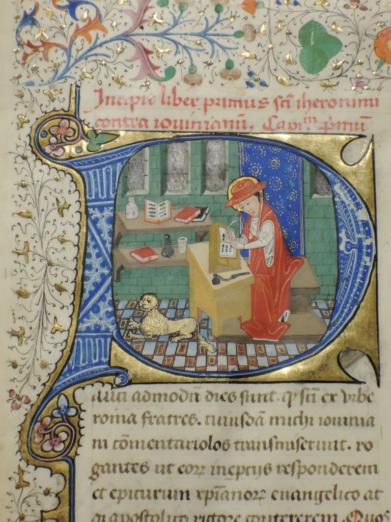 The illustrated opening initial, with the scribal author Jerome, plus lion, for a leaf from 'Otto Ege Manuscript 35', Otto Ege Collection, Beinecke Rare Book and Manuscript Liibrary, Yale University. Photograph courtesy Lisa Fagin Davis. Reproduced by permission. The sainted author, a Church Father, sits at work at his desk, writing his text with a quill pen on a raised lectern, with scribal tools and books displayed on his desk and shelves in his study. His lion crouches on the tiled floor and reflects on his own reflections.