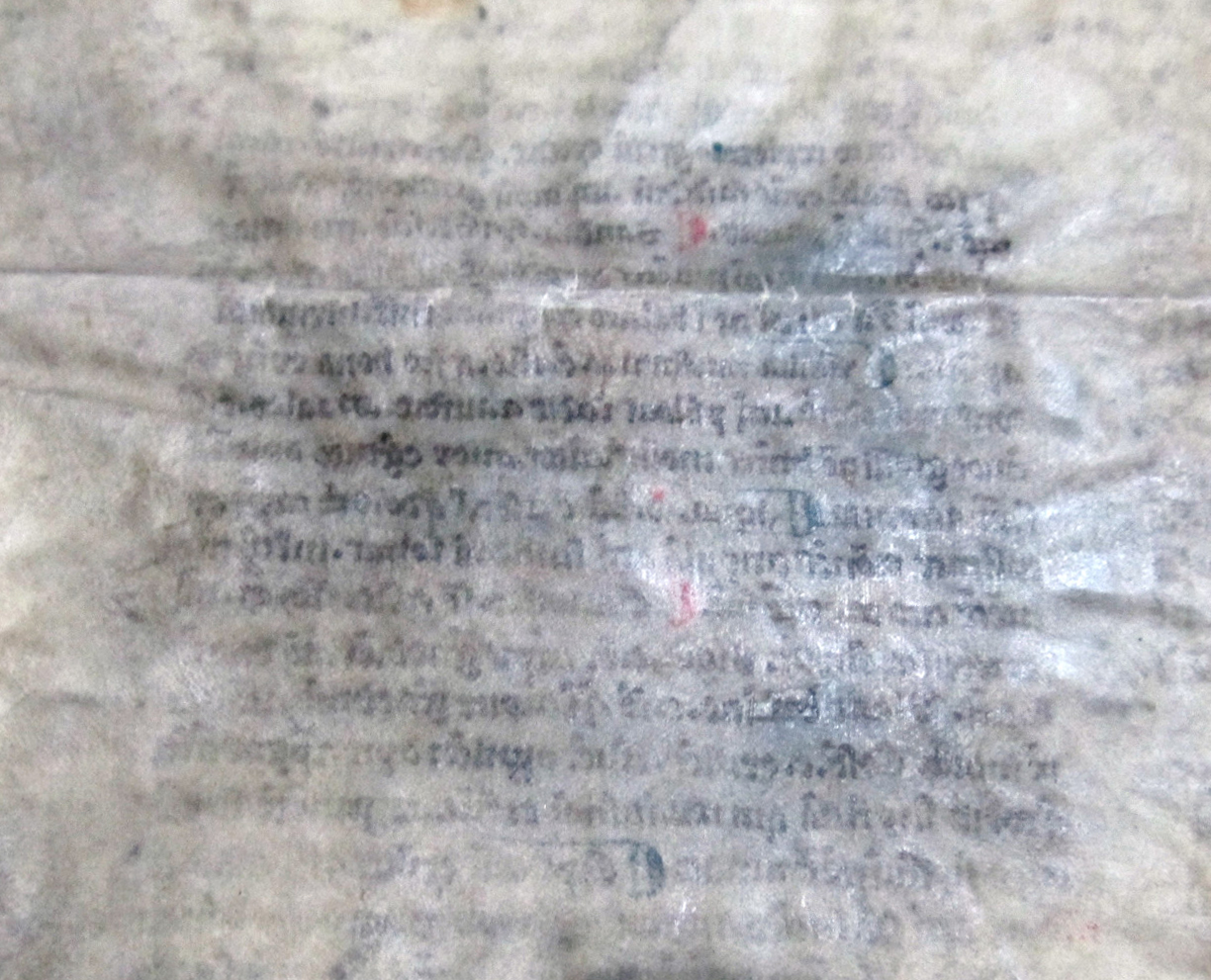 Show Through from the lower part of one column of text on the 'interior' of the bifolium onto its exterior. Reproduced by permission
