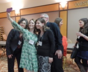 A group gathers spontaneously to enjoy a Selfie at the Co-Sponsored Reception of the Research Group on Manuscript Evidence and the Index of Christian Art at the 2016 International Congress on Manuscript Studies. Photography © Mildred Budny.