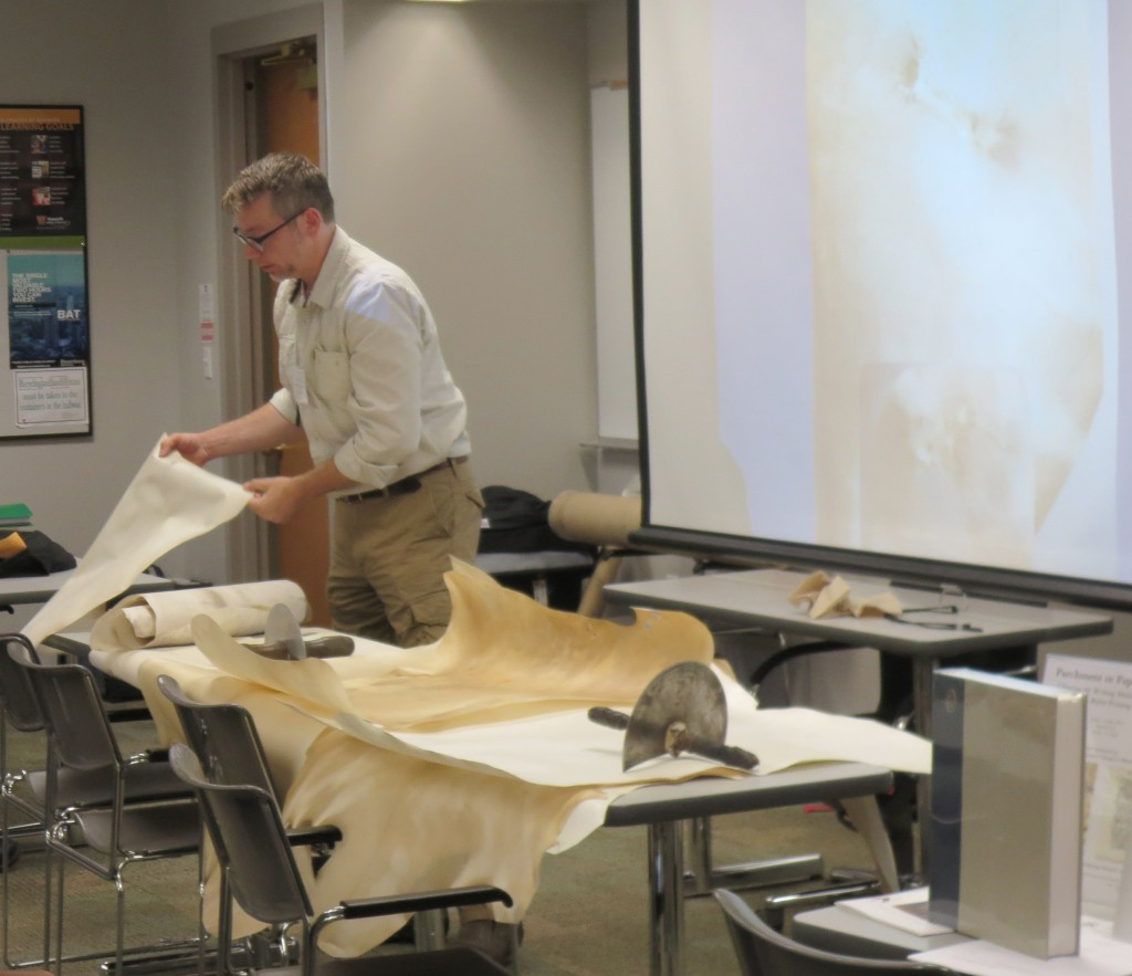 Jesse Meyer demonstrates different types of prepared parchment and tools for the 'Paper or Parchment' Session at the 2016 International Congress on Medieval Studies. Photography © Mildred Budny