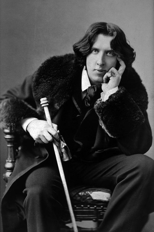 Photograph by Napoleon Sarony (1821-1896) of Oscar Wilde (1856-1900) in 3/4 length with walking stick. Via Wikipedia Commons.