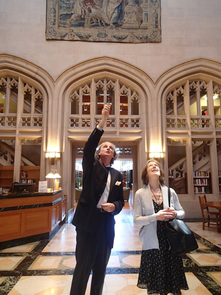 Thomas Hill explains the iconography of the cycle of tapestries adorning the entrance hall to the Vassar College Library. Photography © Mildred Budny