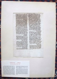 Verso of the Oregon Leaf shown behind its windowed mat, which carries Otto Ege's printed label for the Aristotle manuscript made at Erfurt by 1365 CE.