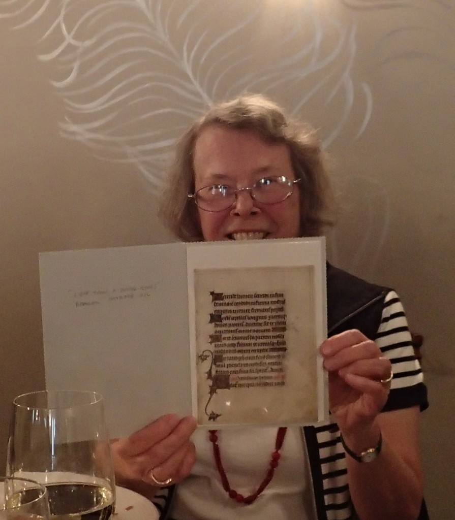 Adelaide Bennett holds up the newly presented leaf from a dismembered Book of Hours which she saw, while still whole, years ago.