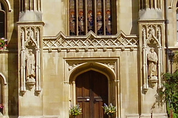 Matthew Parker stands outside the entrance to the Chapel in his College. August 2005. Photography © Mildred Budny.