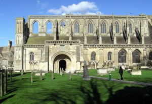Malmesbury Abbey viewed from the graveyard to the South Porch. Photograph by Adrian Pingstone via Wikipedia Commons.