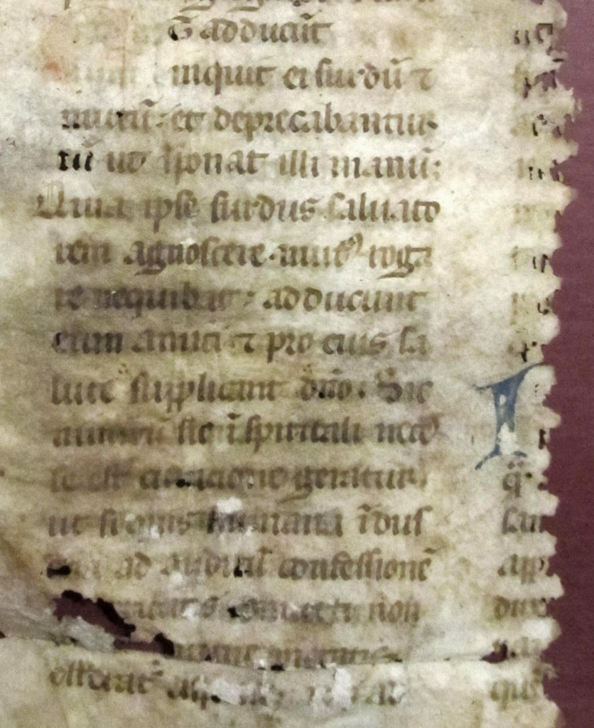 Verso, Lower Right, with parts of the left-hand edge of the mostly-missing column of text and the traces of a blue-green initial.