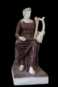 Apollo Seated with Lyre. Porphyry and marble, 2nd century CE. Farnese Collection, Museo Archeologico Nazionale. Photograph by Jebulon via Creative Commons.