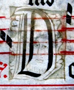 Initial D for 'Domine' with inset bearded human head seen in 3/4 view peeping toward the left, on the recto of a detached leaf in a private collection. Reproduced by permission.