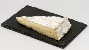 Slice of Brie. Photograph by Coyau via Wikipedia Commons.