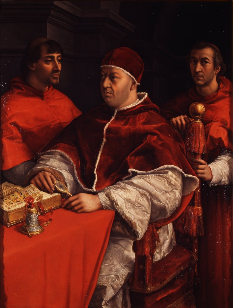 Portrait by Raphael Sanzio (circa 1518) of Pope Leo X and his First Cousins, Cardinals Giulio de' Medici (later Pope Clement VII) and Luigi de' Rossi. Uffizi gallery, Florence. Via Creative Commons.