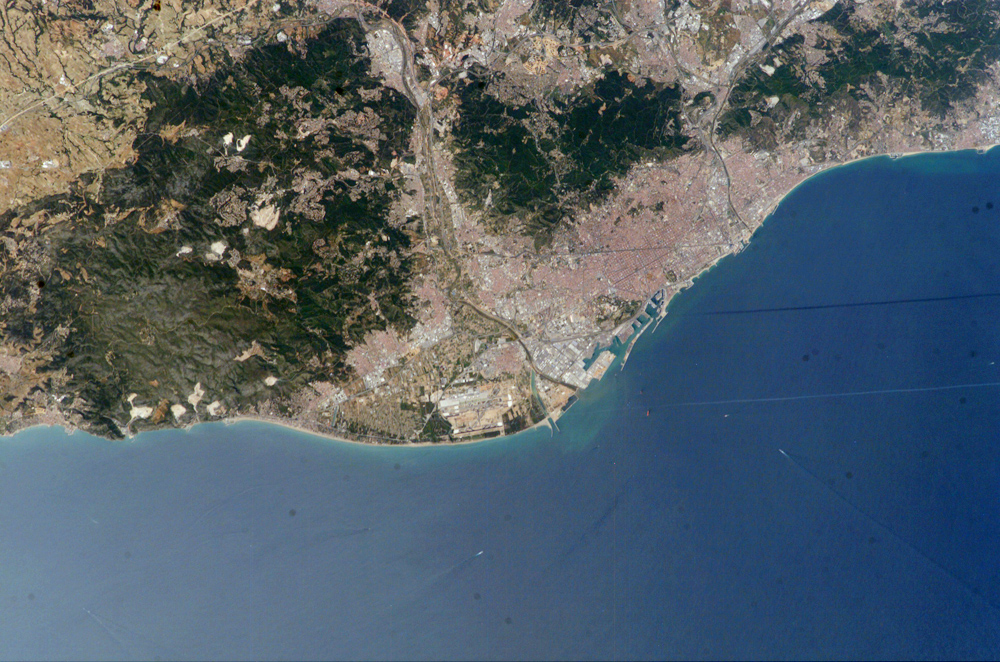 Astronaut photo of Barcelona, Catalonia, Spain (3 June 2004).  Via Earth Observations Laboratory, Johnson Space Center.  NASA, public domain.
