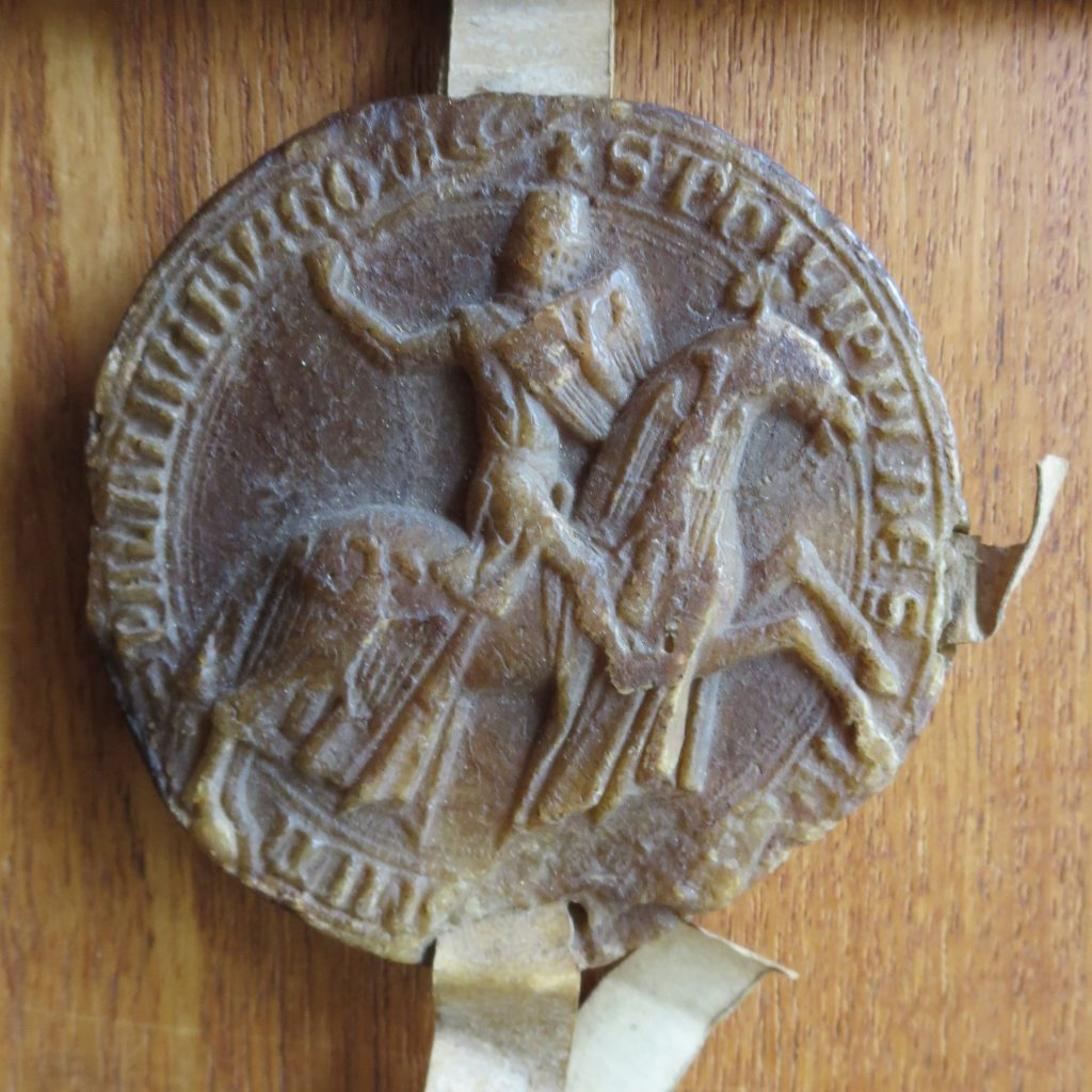Equestrian Wax Seal of Philip I, Count of Savoy, Affixed to his Judgment of Abritration, 28 May 1275. Photograph by Mildred Budny.