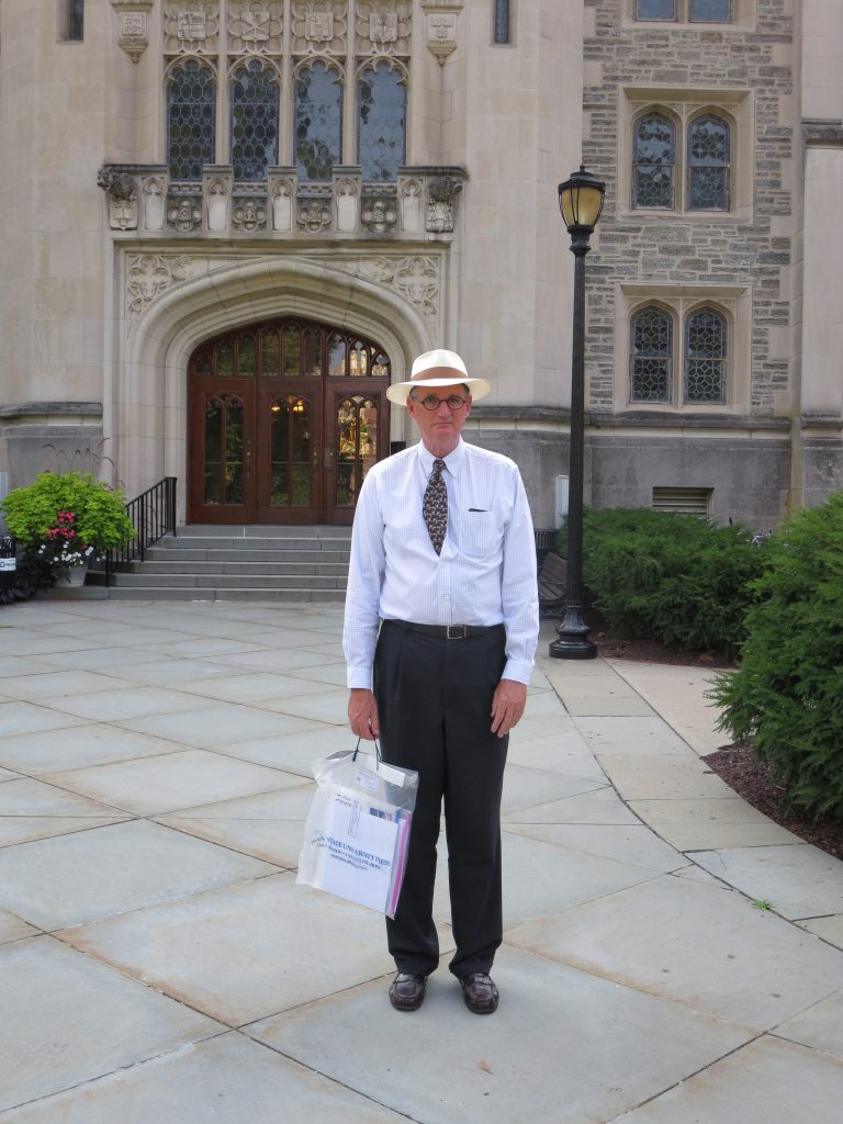 Thomas E. Hill stands at the entrance to the Vassar College Library. Photography by Mildred Budny