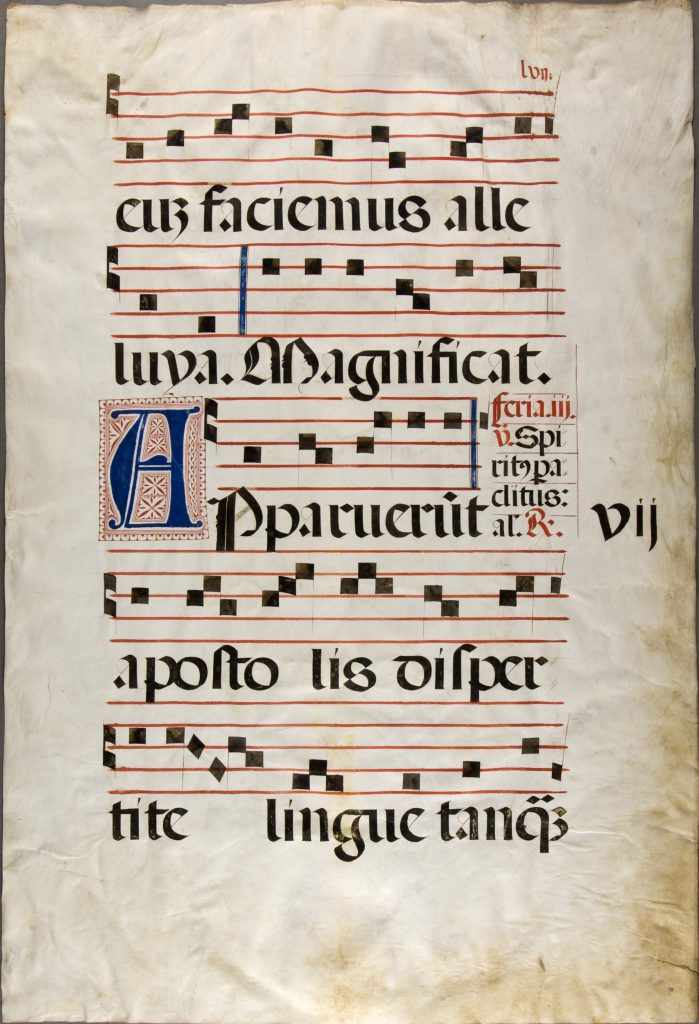 Vassar College Libraries, Medieval and Early Modern Manuscript Collections, Archives and Special Collections (ASC), Item 69, recto. Leaf from an Antiphonary, including the text for the celebration of Pentecost in the Missal. The musical notation is set out on 5-line stages and the opening inset blue initial of A for 'Appareunt' has a rectangular bed of red decoration.