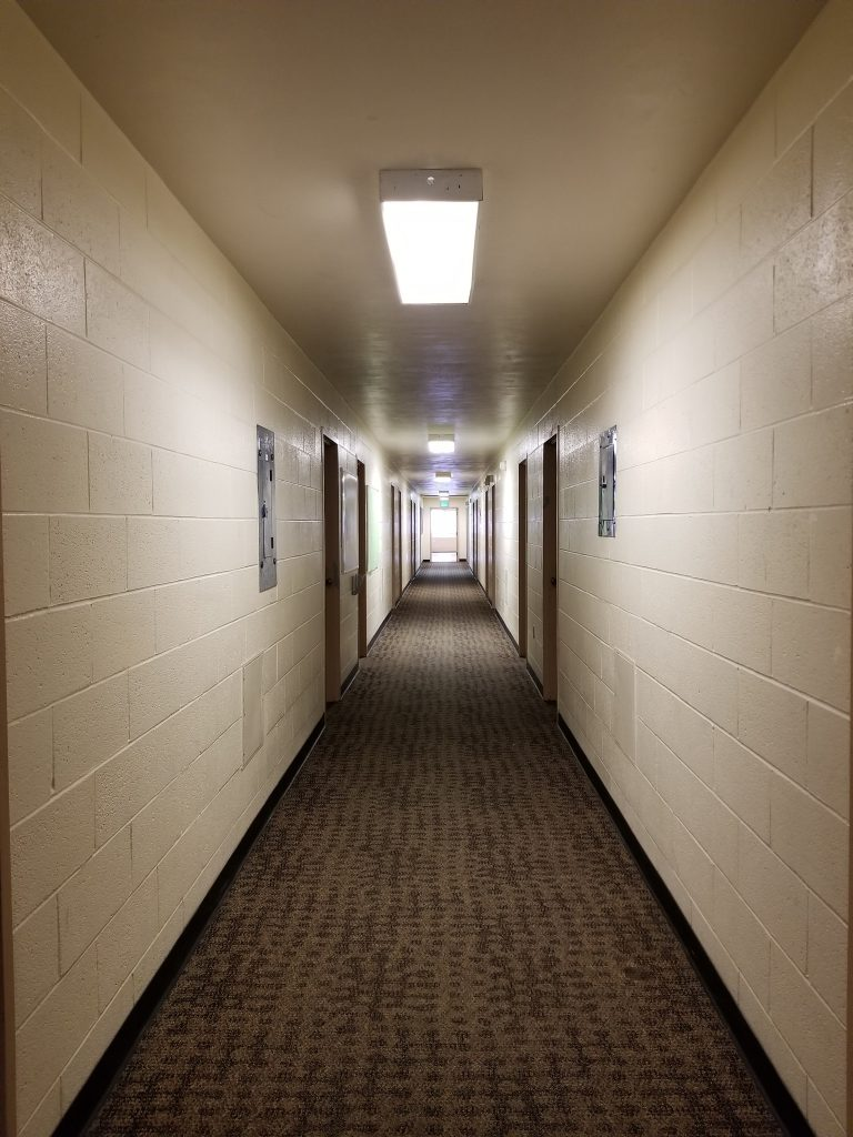 At the End of the 2019 Congress. A view down the dorm corridor, with Light at the End of the Tunnel.