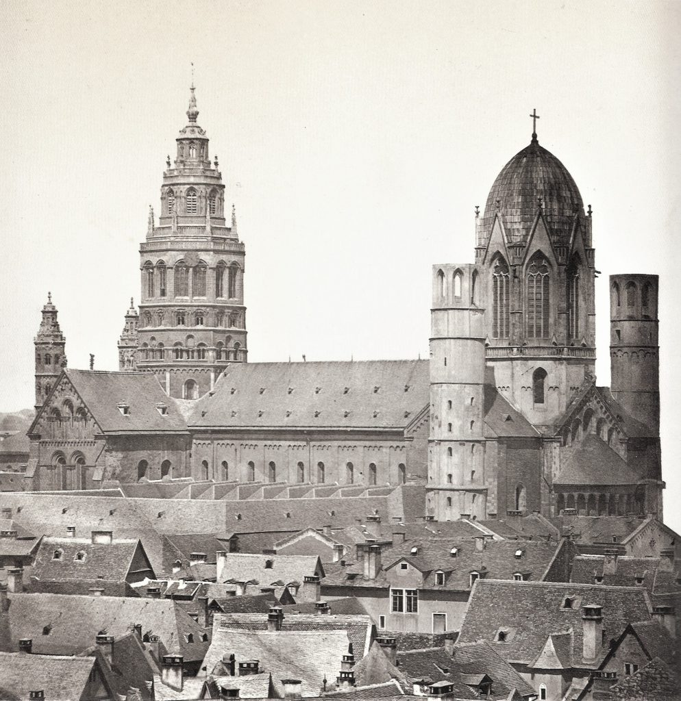 Mainz Cathedral from SE before 1858. Photograph published by Hermann Emden (1858). Public Domain, via Wikimedia Commons.