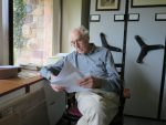 Giles Reading at the Window in his Office at the IAS. Spring 2014. Photography Mildred Budny.